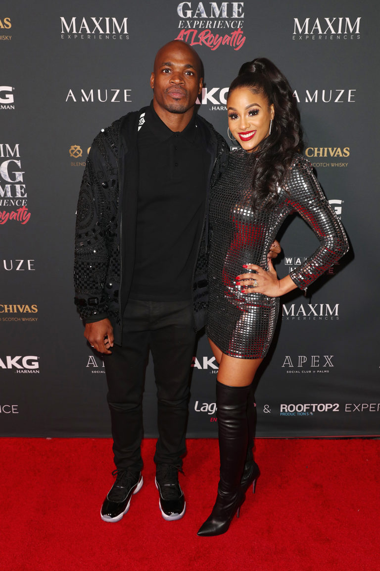 Adrian Peterson (L) and Ashley Brown Peterson attends The Maxim Big Game Experience (Photo by Joe Scarnici/Getty Images for Maxim)