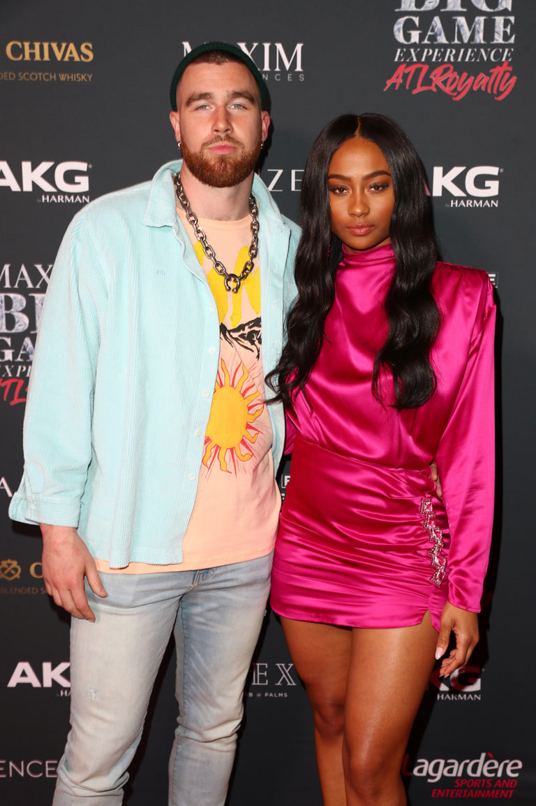 Travis Kelce (L) and Kayla Nicole attends The Maxim Big Game Experience (Photo by Joe Scarnici/Getty Images for Maxim)
