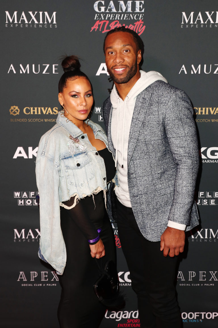 Larry Fitzgerald (R) and Melissa Fitzgerald attend The Maxim Big Game Experience (Photo by Joe Scarnici/Getty Images for Maxim)